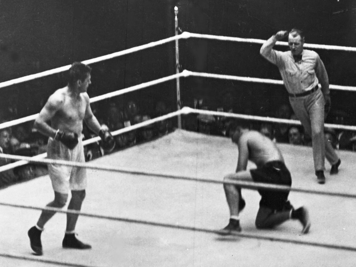 This Sept. 22, 1927 file photo shows Jack Dempsey going down on one knee during his heavyweight title fight against Gene Tunney, in Chicago. Tunney's unusual life of boxing and books will be on display on Thursday in an auction of his memorabilia by Sothe