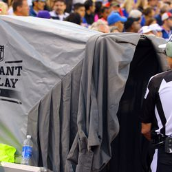 Aug 16, 2013; Orchard Park, NY, USA;  NFL referee Tony Corrente (99) watches a TV during a instant replay in a game between the Buffalo Bills and the Minnesota Vikings at Ralph Wilson Stadium.