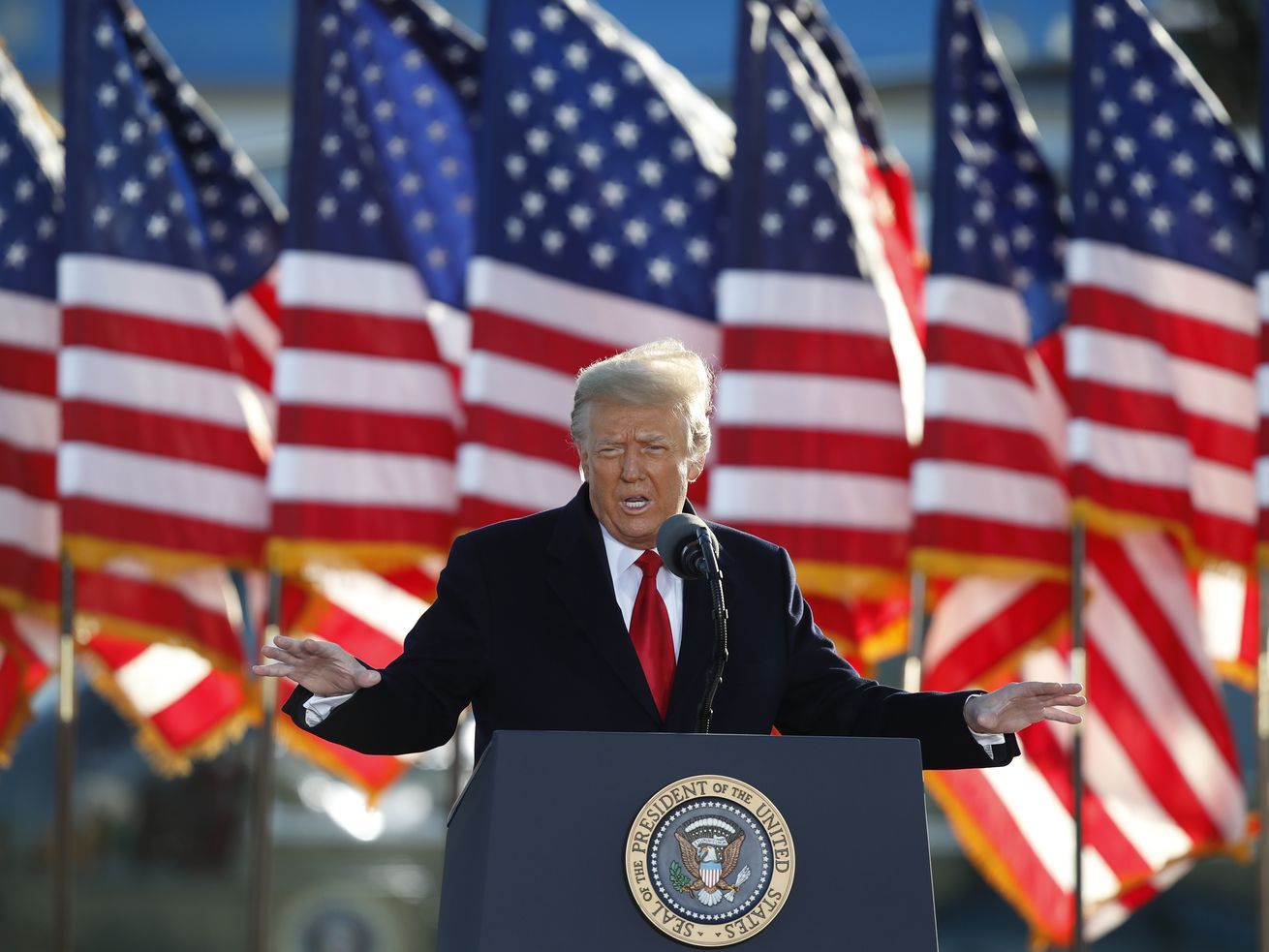 President Donald Trump speaks to crowd before boarding Air Force One at Andrews Air Force Base, Md., in this Wednesday, Jan. 20, 2021, file photo. Former President Donald Trump will find out this week whether he gets to return to Facebook.
