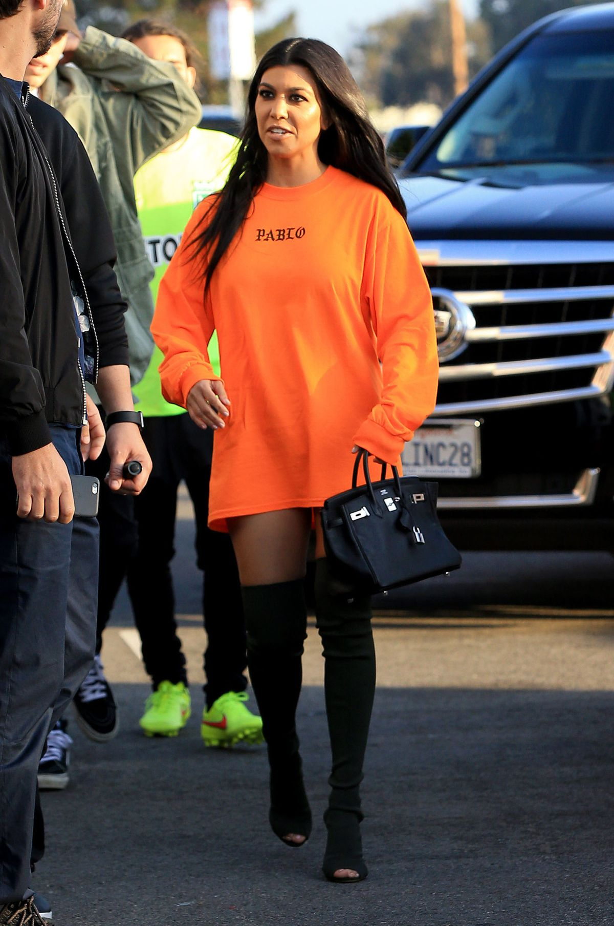 Kourtney Kardashian in a sweatshirt from Kanye West's The Life of Pablo collection.
