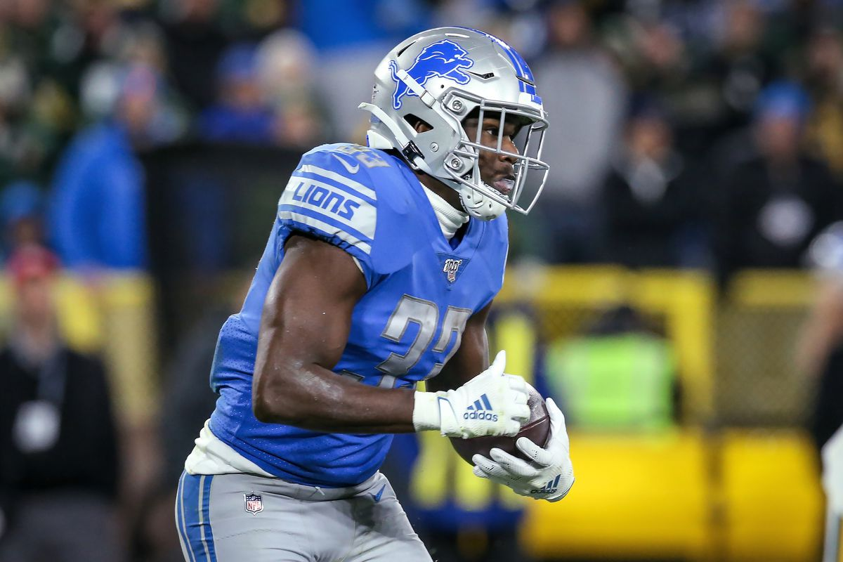 Kerryon Johnson #33 of the Detroit Lions runs with the ball in the second quarter against the Green Bay Packers at Lambeau Field on October 14, 2019 in Green Bay, Wisconsin.