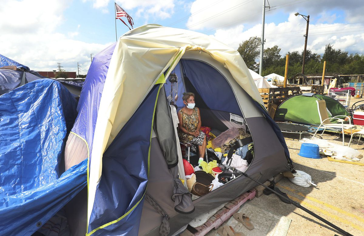 Erica Soto sits in her tent at Camp Esperanza homeless camp in Austin, Texas, on Tuesday Oct 20, 2020.