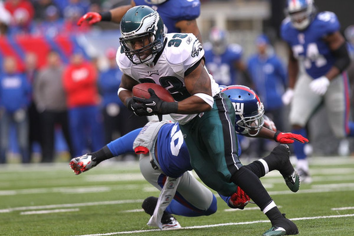EAST RUTHERFORD NJ - DECEMBER 19: Jerome Harrison #33 of the Philadelphia Eagles runs with the ball against the New York Giants at New Meadowlands Stadium on December 19 2010 in East Rutherford New Jersey.  (Photo by Nick Laham/Getty Images)