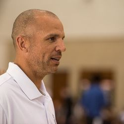 Jason Kidd speaks to his assistants before game one