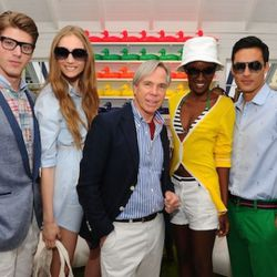 Designer Tommy Hilfiger poses with models at the launch of Prep World NYC