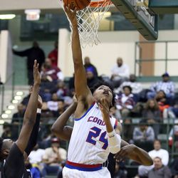 Curie's Justin Harmon (24) scores against Orr in  their CPS semi final game at Chicago State University, Friday, February 15, 2019. | Kevin Tanaka/For the Sun Times