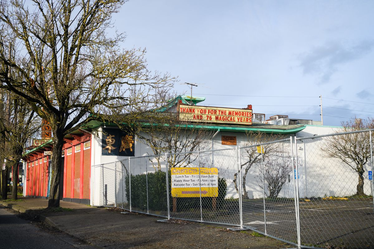 """Blocked by a chain-link fence, Canton Garden's marquee reads """"Thank you for the memories and 76 magical years."""""""