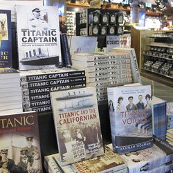 Books covering myriad Titanic topics are piled high at the entrance to the Belfast Titanic gift shop in Belfast, Northern Ireland, on Wednesday, March 28, 2012.