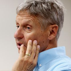 Libertarian presidential candidate Gov. Gary Johnson answers a question from the media as he and running mate Gov. Bill Weld attend a rally in Salt Lake City at the University of Utah on Saturday, Aug. 6, 2016.