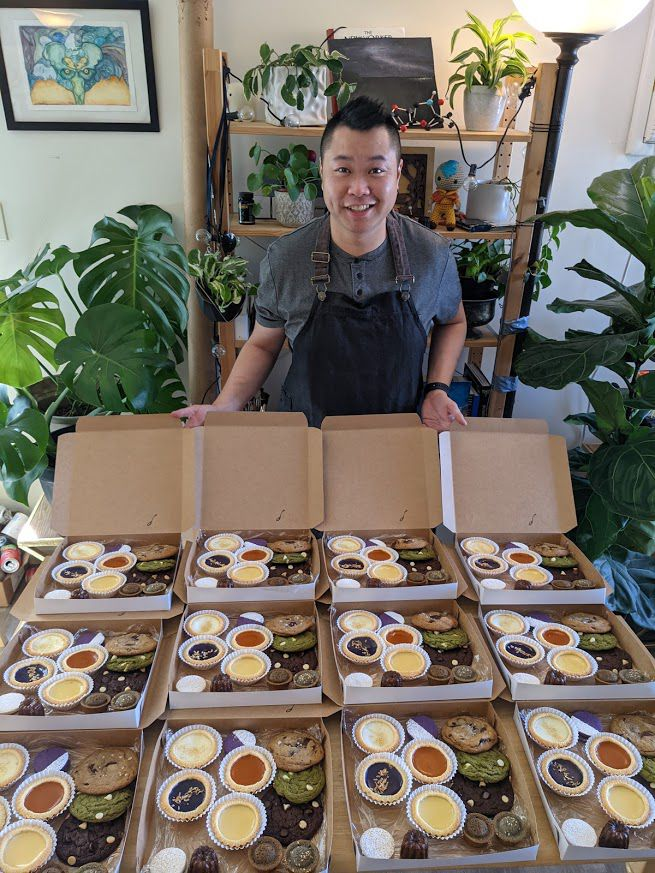 Steven Cheung with sampler boxes at his home business Spoons Patisserie