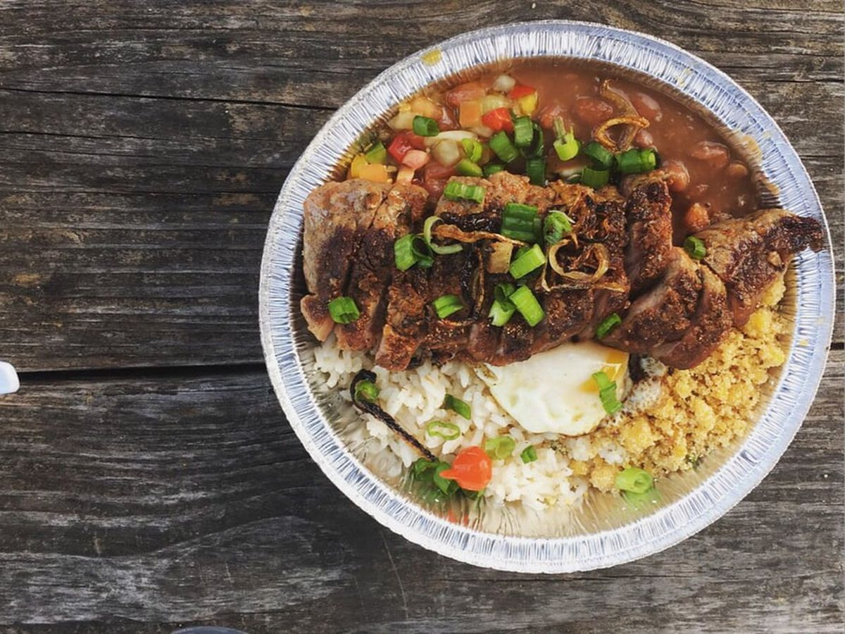 The picanha grelhada from Boteco, with sirloin steak, rice, beans, fried egg, toasted yucca flour, and pepper.