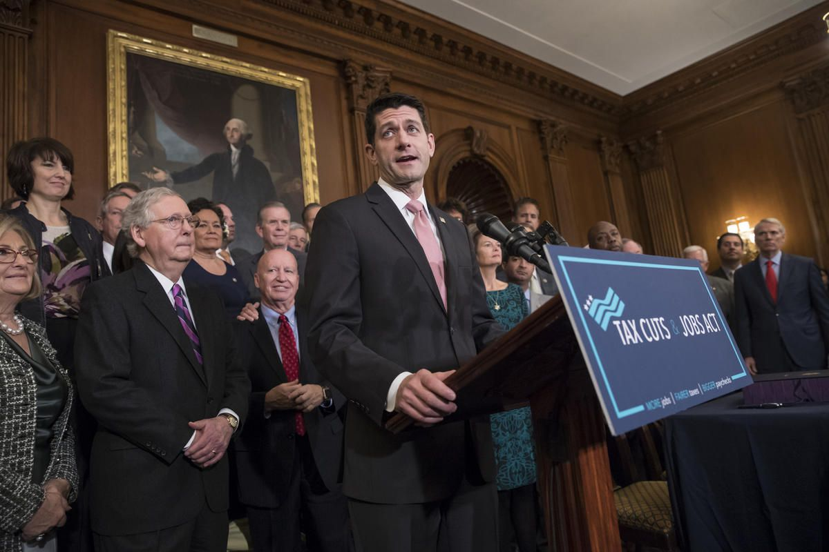 Speaker of the House Paul Ryan, R-Wis., joined by, from left, House Budget Committee Chair Diane Black, R-Tenn., Senate Majority Leader Mitch McConnell, R-Ky., and House Ways and Means Committee Chairman Kevin Brady, R-Texas, praises the Republican tax bi