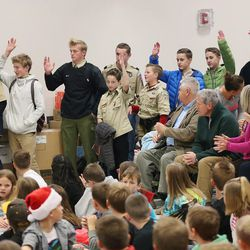 Boy Scouts are acknowledged for their work helping get this year's Santa Flight off the ground during a ceremony at Hurricane Elementary School in Hurricane on Wednesday, Dec. 7, 2016. Pilots with the Utah Wing of Angel Flight West filled 16 aircraft with 7,000 pounds toys, school supplies, books, backpacks and warm clothing for students at the Title I school. The items were gathered by 16 Boy Scouts as part of their Eagle Scout service project. Since the first Santa Flight in 2000, members of the Utah Wing have worked with their local communities to gather needed supplies and toys, and deliver them to Title I schools in rural communities throughout Utah.