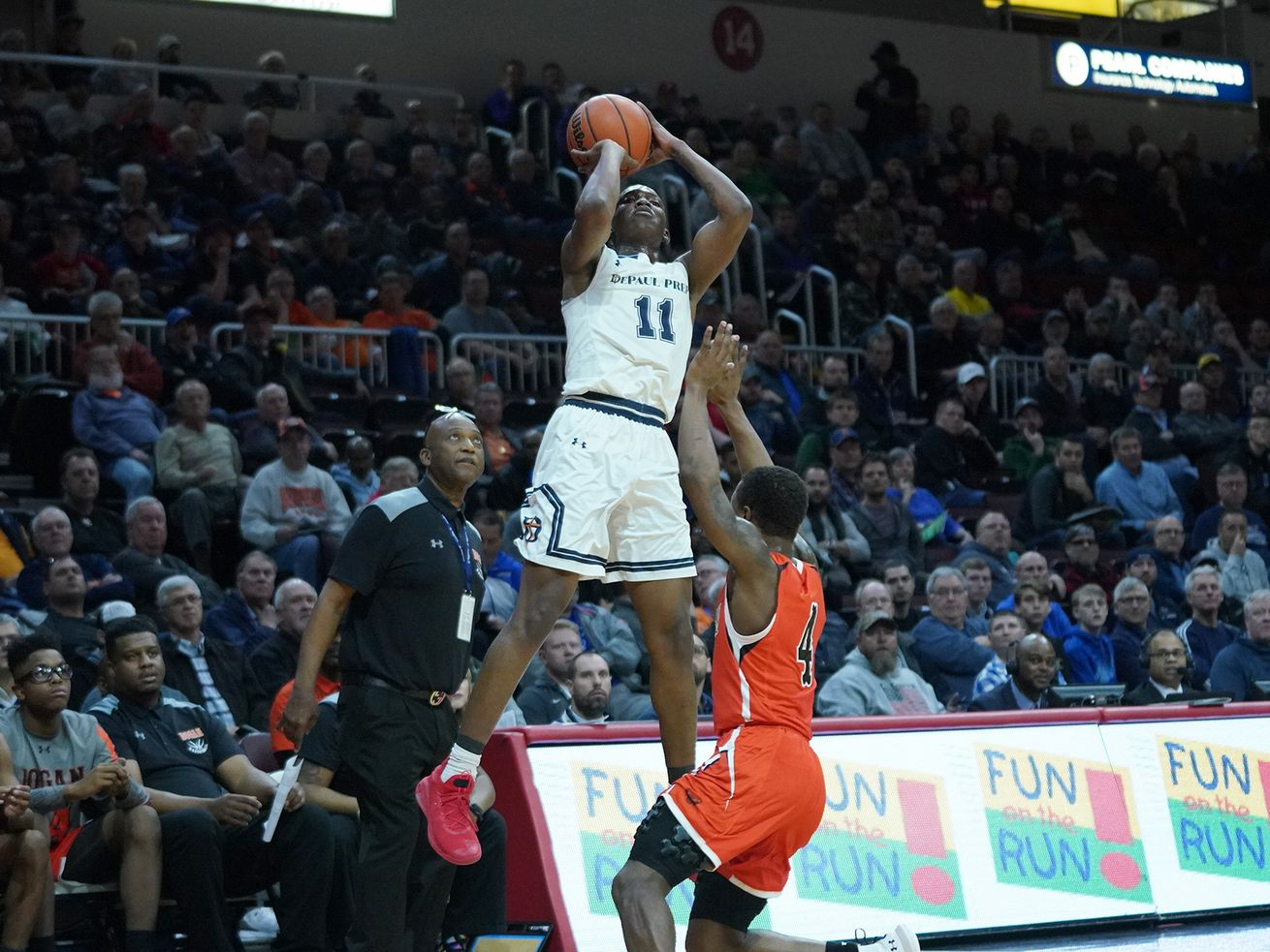 DePaul Prep's Perry Cowan (11) pulls up a three pointer against Bogan at state in 2019.