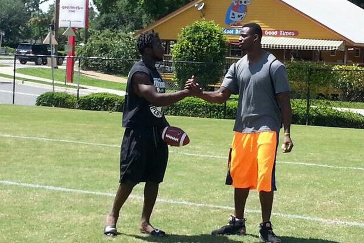 Dalvin Cook (left) and FSU linebacker Matthew Thomas (right)