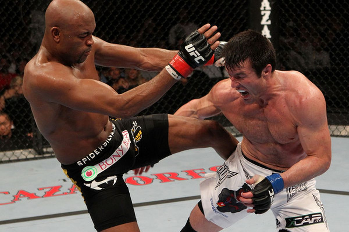OAKLAND CA - AUGUST 07:  Anderson Silva kicks Chael Sonnen during the UFC Middleweight Championship bout at Oracle Arena on August 7 2010 in Oakland California.  (Photo by Josh Hedges/Zuffa LLC/Zuffa LLC via Getty Images)