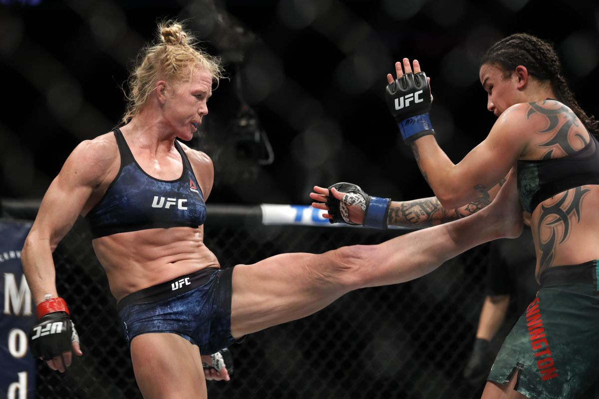 Holly Holm kicks Raquel Pennington in bantamweight bout during UFC 246 at T-Mobile Arena on January 18, 2020 in Las Vegas, Nevada.