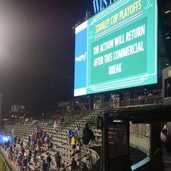 9:35 p.m. Fans in left field waiting -