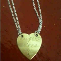 """In God We Trust """"Someone Likes Me"""" necklace ($200)."""