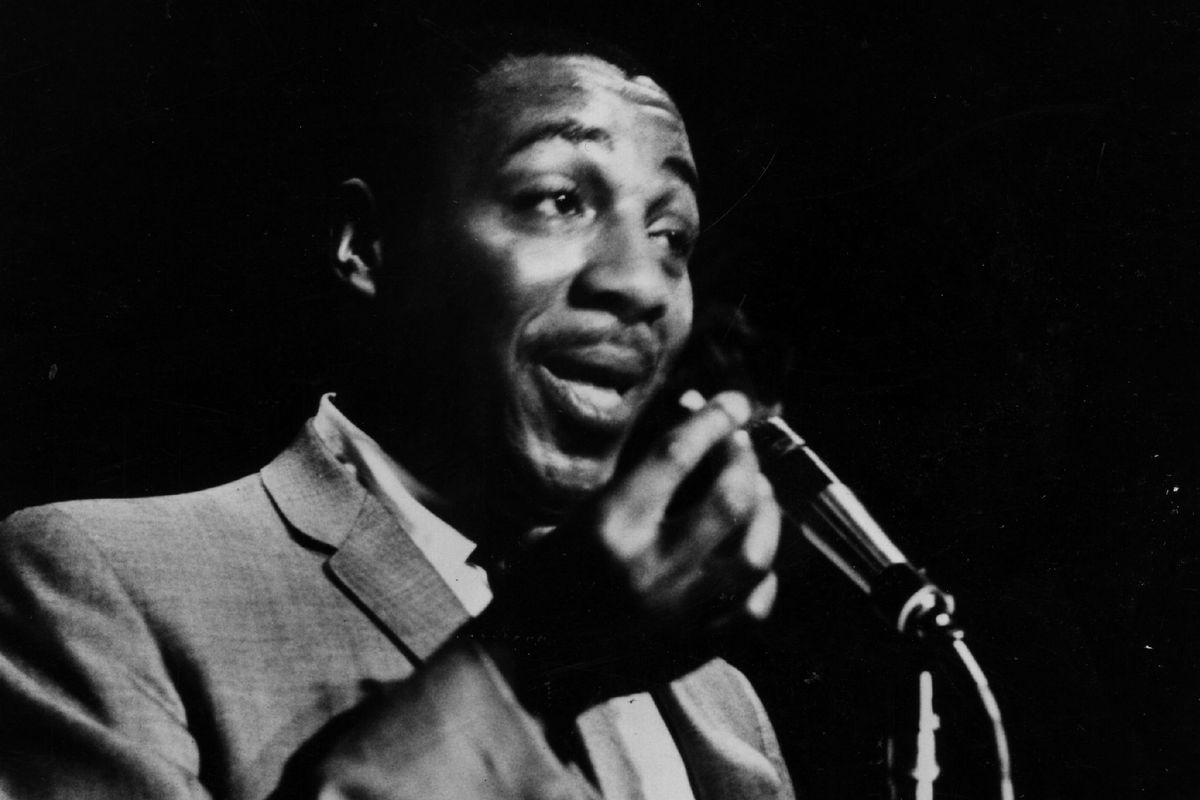 Comedian Dick Gregory at the microphone in 1962.