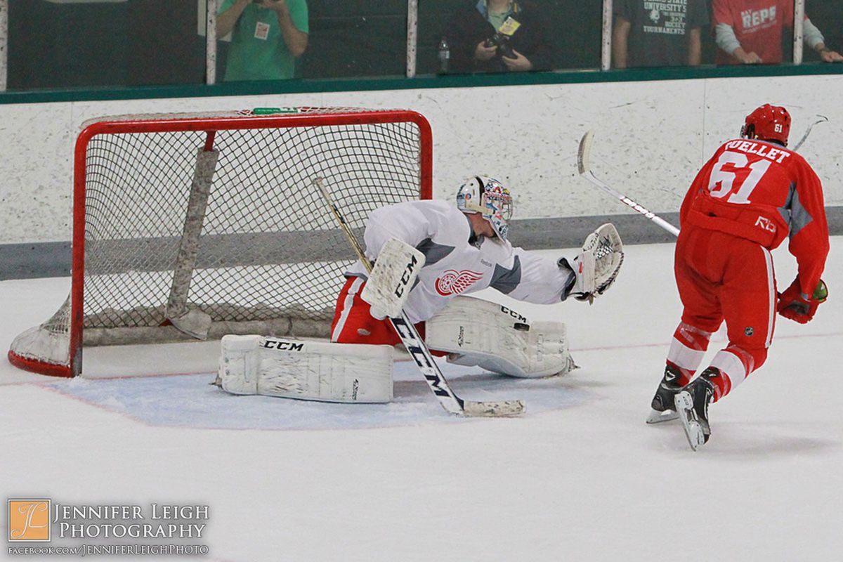 Jake Paterson stops a shot from Xavier Ouellet