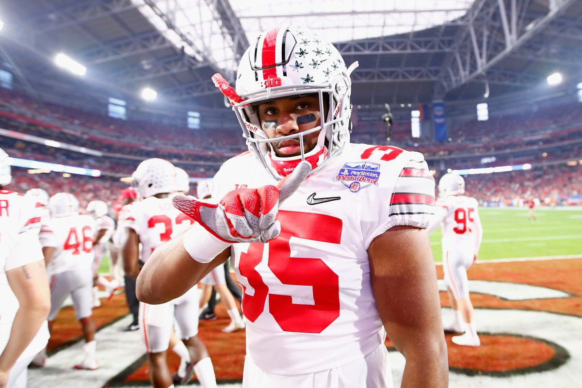 GLENDALE, AZ:  Ohio State Buckeyes middle linebacker Chris Worley gestures to the cameras prior to the 2016 PlayStation Fiesta Bowl against  the Clemson Tigers at University of Phoenix Stadium.