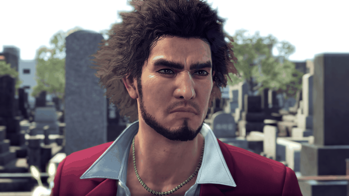 Yakuza: Like a Dragon's protagonist Ichiban, looking solemn while standing in a graveyard