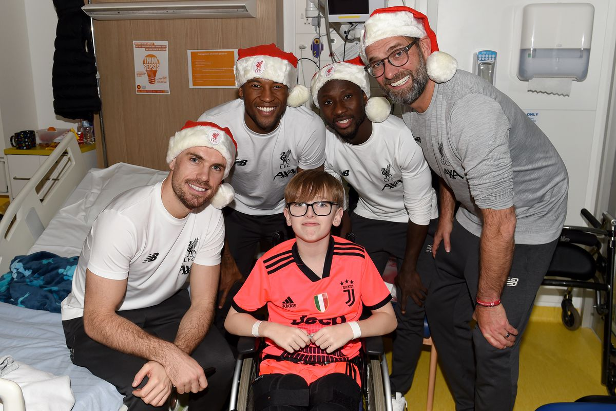 Liverpool Players Deliver Christmas Gifts to Alder Hey Hospital