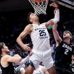 Brigham Young Cougars forward Gavin Baxter (25) goes to the hoop between Gonzaga Bulldogs forward Corey Kispert (24) and forward Drew Timme (2) at the Marriott Center in Provo on Saturday, Feb. 22, 2020.
