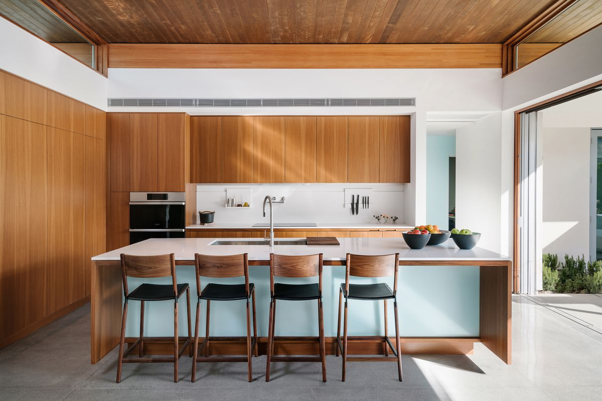 Kitchen featuring breakfast bar and stools