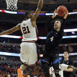 BYU guard Nick Emery, right, drives to the basket against Illinois guard Malcolm Hill during the second half of an NCAA college basketball game Saturday, Dec. 17, 2016, in Chicago. Illinois won 75-73. (AP Photo/Nam Y. Huh)