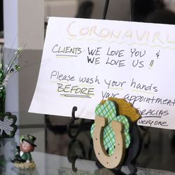 A sign at Color My Nails in Midvale on Wednesday, March 25, 2020, directs clients to wash their hands during the COVID-19 pandemic. Small businesses are struggling with a loss of business due to the novel coronavirus.