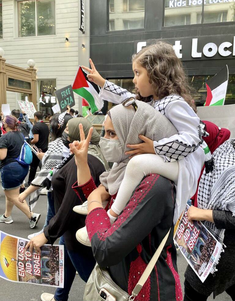 Fidaa Elaydi with her daughter at one of the recent pro-Palestine protests in Chicago.