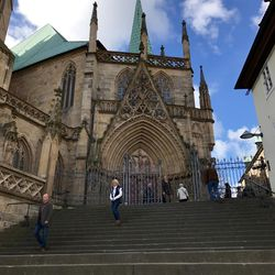The Cathedral of St. Mary, where Martin Luther was ordained a Catholic priest in 1507, towers above the town of Erfurt with steps leading down to the town plaza.