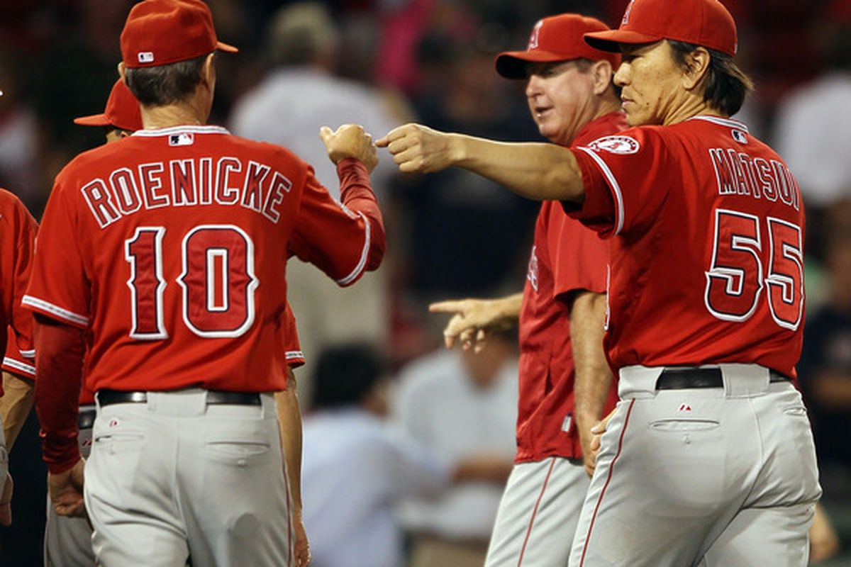 BOSTON - AUGUST 19:  Hideki Matsui #55 of the Los Angeles Angels of Anaheim celebrates the win with Ron Roenicke #10 on August 19 2010 at Fenway Park in Boston Massachusetts. The Angels defeated the Boston Red Sox 7-2.  (Photo by Elsa/Getty Images)