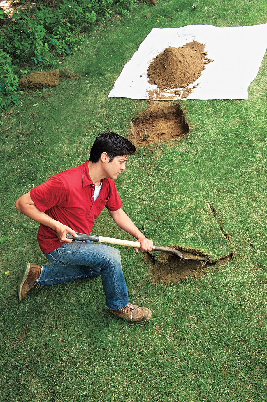 Man Digs Up Soil To Place Planter Base In Ground
