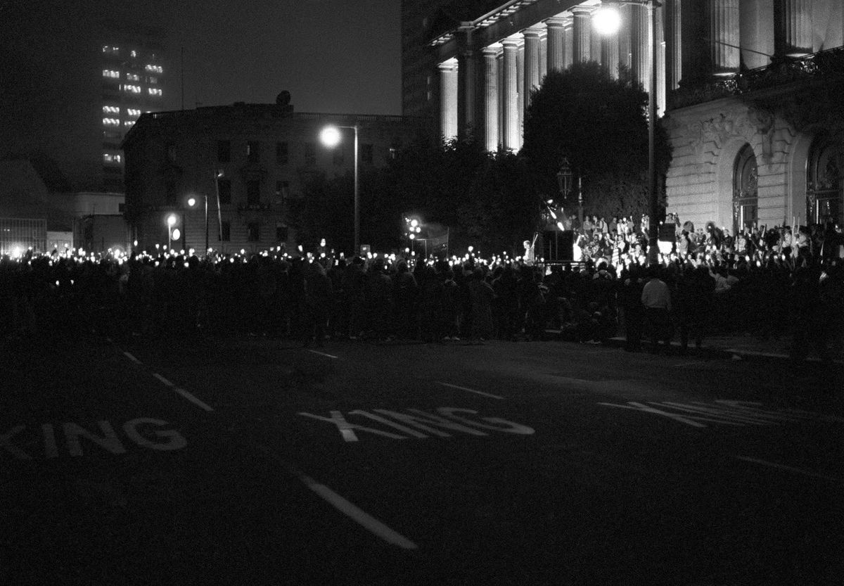 """Catherine Opie, """"San Francisco City Hall, Candle¬light March for AIDS #1, 1986."""" 