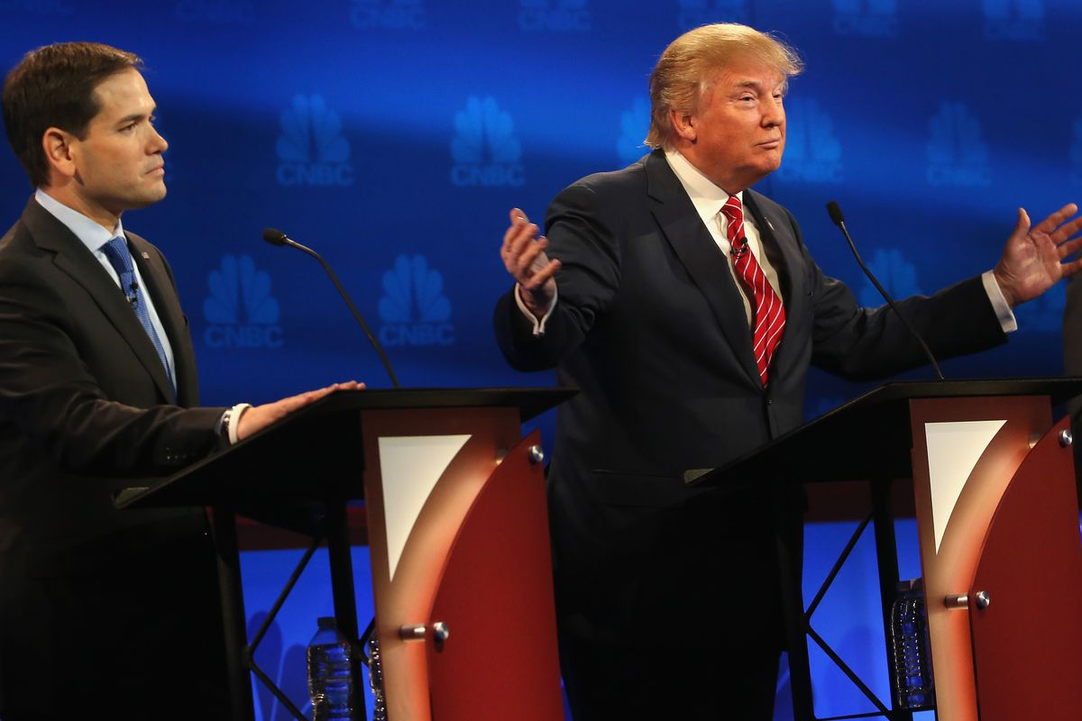 Presidential candidates Donald Trump (L) speaks while Ben Carson (R) and Sen. Marco Rubio (R-FL) look on during the CNBC Republican presidential debate at University of Colorado's Coors Events Center October 28, 2015, in Boulder, Colorado.