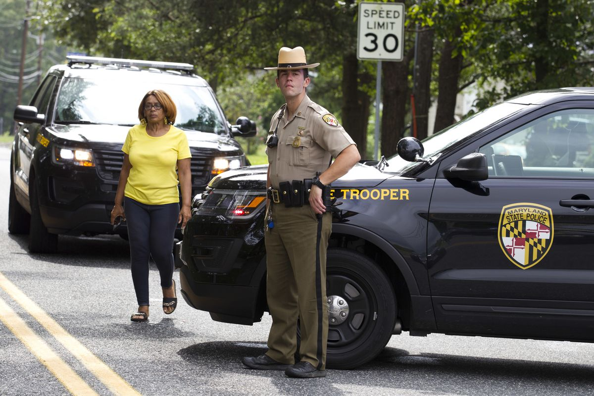 A state police officer stands by at the scene of a mass shooting in Aberdeen, Maryland.