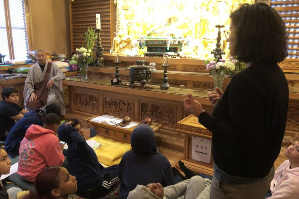 Jody Madell and her ninth-grade students at Chogyesa Zen Temple of New York.