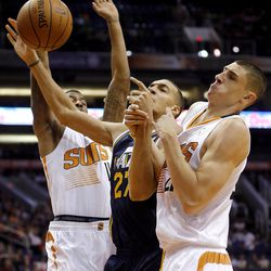 Phoenix Suns' Alex Len, right, and Markieff Morris, left, collide with Utah Jazz center Rudy Gobert (27) during the first half of an NBA basketball game Friday, Nov. 1, 2013, in Phoenix.