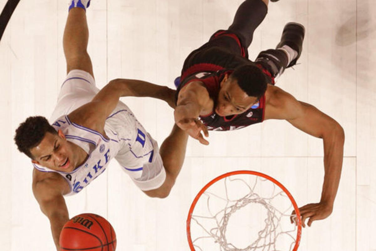 Duke's Frank Jackson, left, drives past Troy's B.J. Miller, right, during the second half in a first-round game of the NCAA men's college basketball tournament in Greenville, S.C., Friday, March 17, 2017.