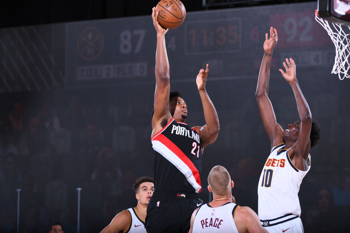 Hassan Whiteside of the Portland Trail Blazers shoots the ball against the Denver Nuggets on August 6, 2020 at Visa Athletic Center at ESPN Wide World of Sports in Orlando, Florida
