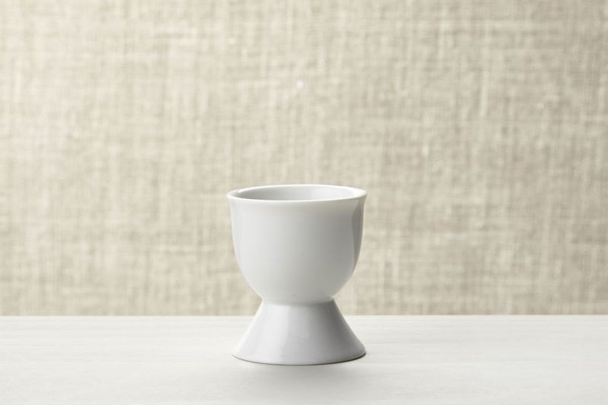 An empty white egg cup