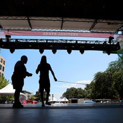Workers from Anchor Stage Management set up for the Utah Arts Festival in Salt Lake City on Wednesday, June 21, 2017.