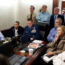 FILE - In this May 1, 2011, image released by the White House and digitally altered by the source to obscure the details of a document in front of Secretary of State Hillary Rodham Clinton, at right with hand covering mouth, President Barack Obama, second from left, Vice President Joe Biden, left, Secretary of Defense Robert Gates, right, and members of the national security team watch an update on the mission against Osama bin Laden in the Situation Room of the White House in Washington. When Obama first spoke of bin Laden's demise, he asked the nation to think back to the unity of Sept. 11. Now the killing of America's most wanted is something else: a concentrated campaign weapon against Mitt Romney, even a bumper sticker message.