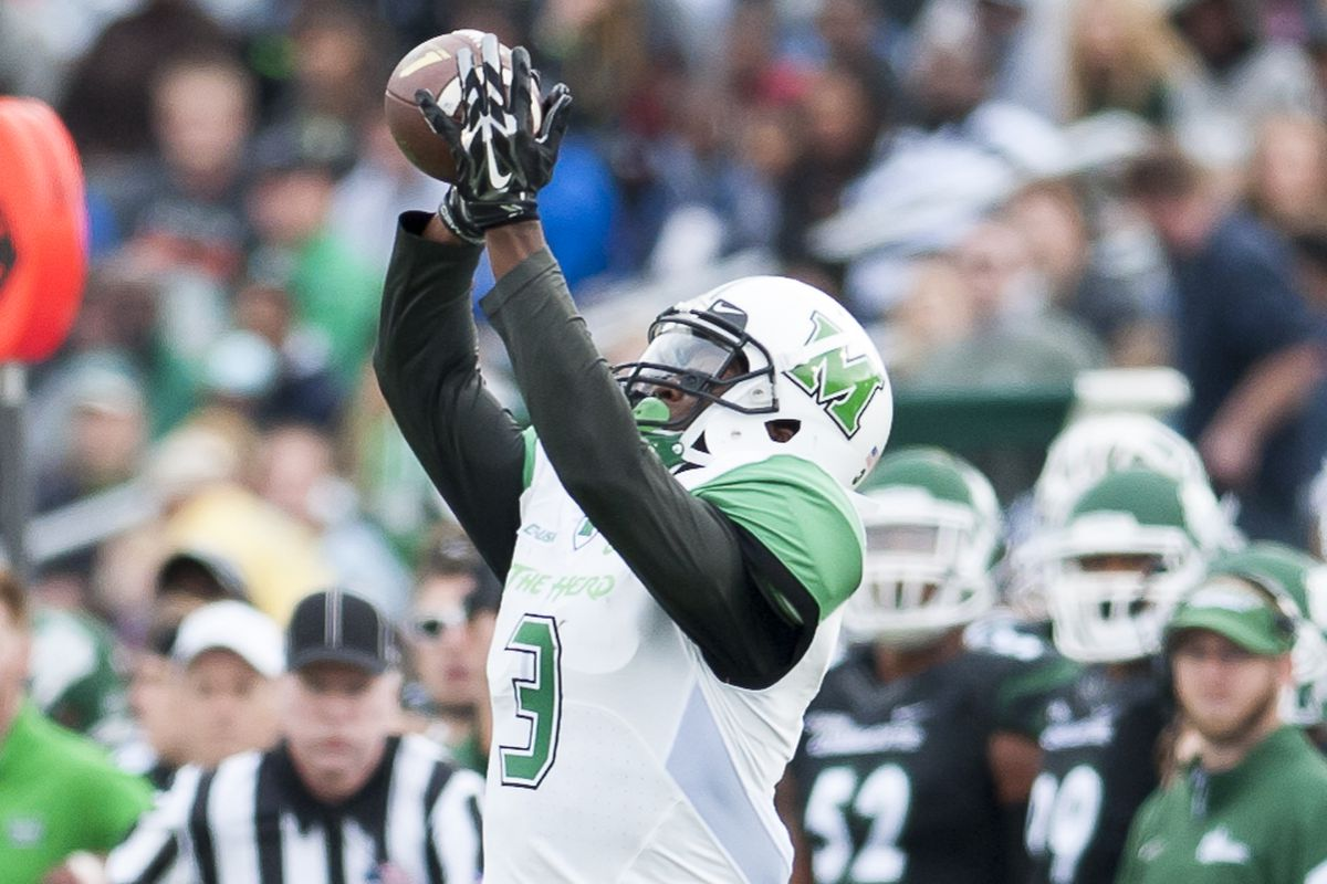 Marshall's Davonte Allen (3) hauls in a pass in the Herd's win over Charlotte.