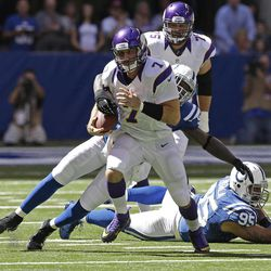 Minnesota Vikings' Christian Ponder (7) is tackled by Indianapolis Colts' Robert Mathis (98) during the first half of an NFL football game in Indianapolis, Sunday, Sept. 16, 2012.
