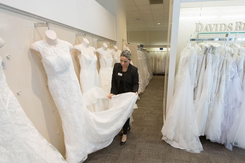 a davids bridal dress consultant tends to a display photo by alex ulreich for racked