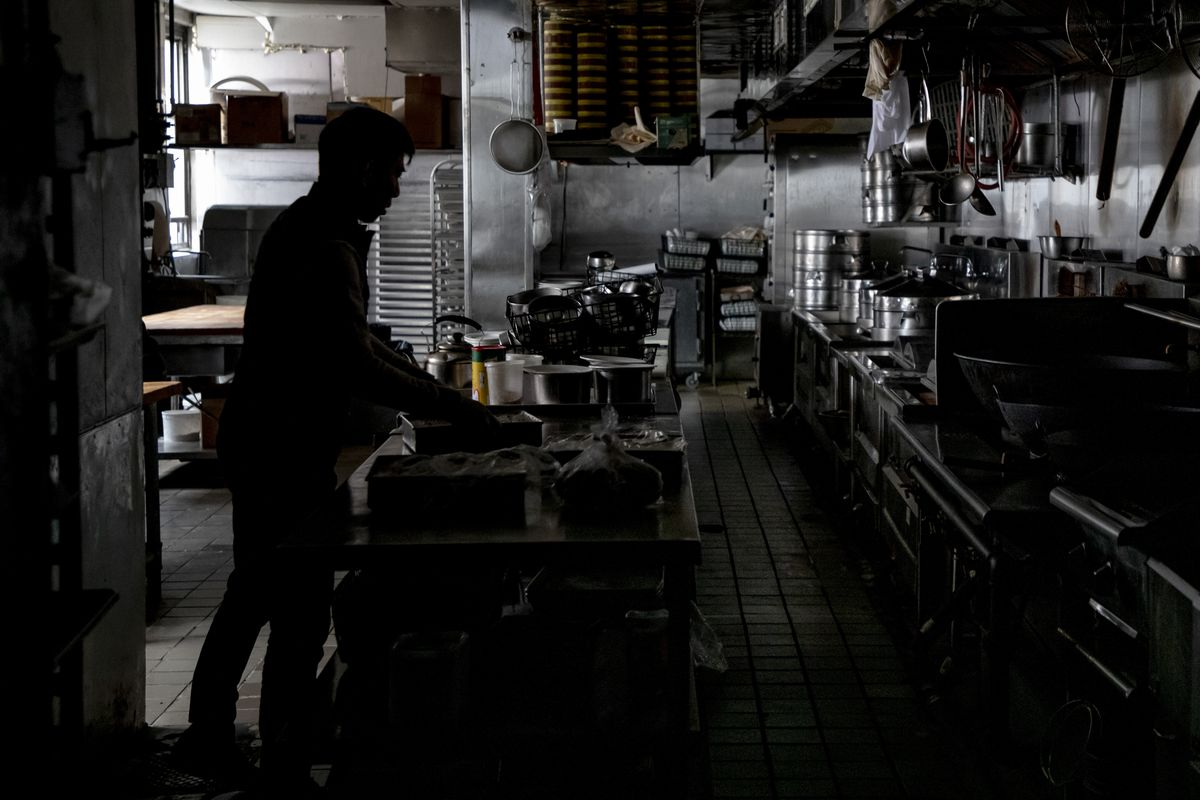 A silhouette of a man in a kitchen